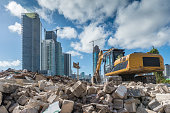 Heavy machinery cleaning a rubble site for a new housing development site in Miami.