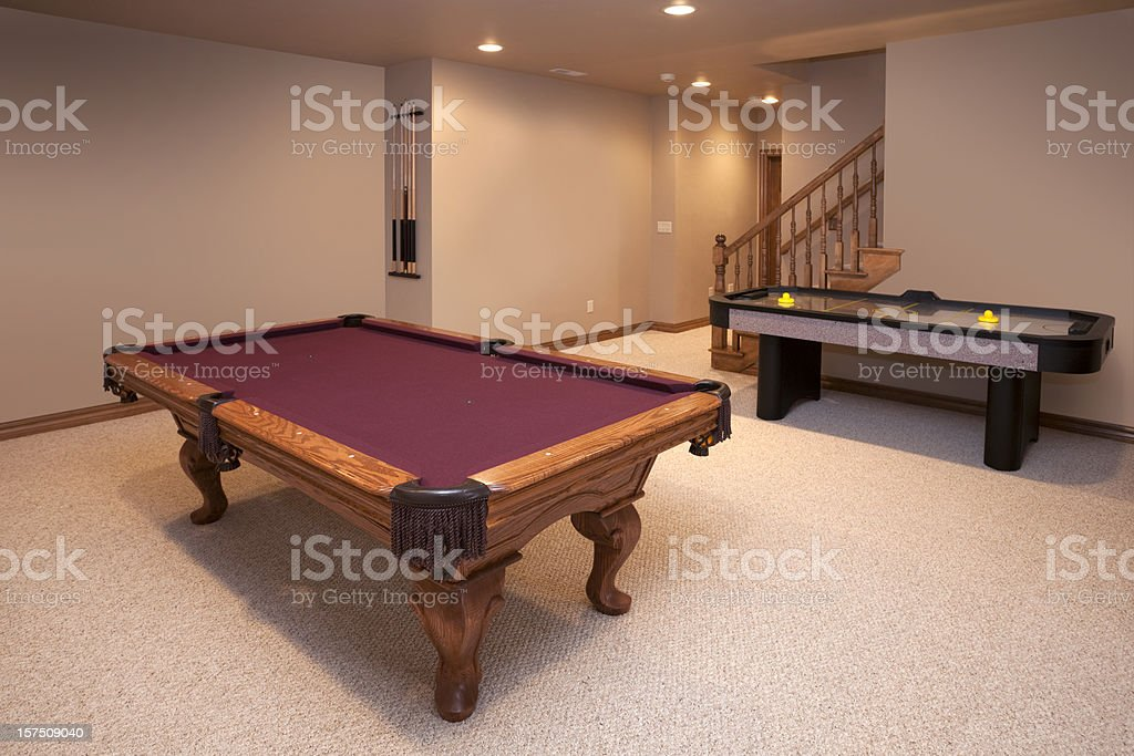 New Game Room With Pool and Air Hockey Tables stock photo
