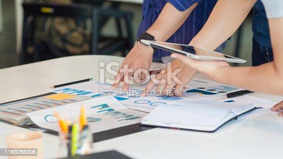 1068752548istockphoto New generation businessmen analyze and plan business marketing strategies. 1163285005