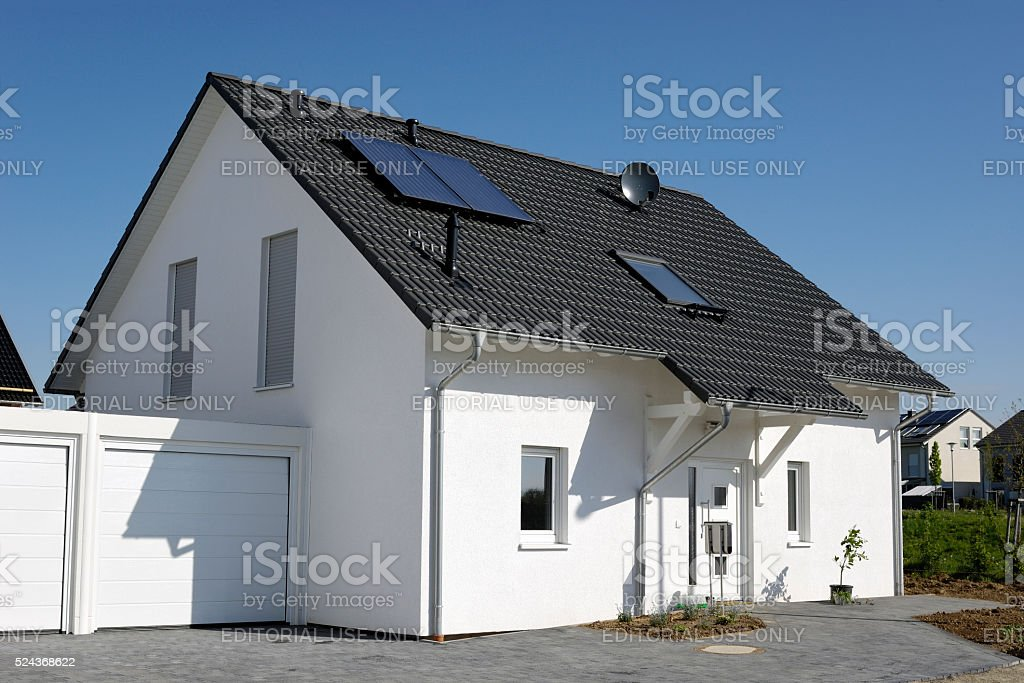 New generic one family house with garage stock photo