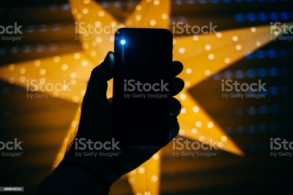 New generic smartphone with star in the background perfect Christmas gift stock photo