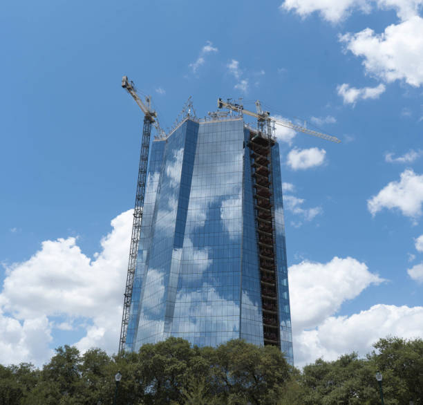 New Glass Building Construction with Cranes on Top stock photo