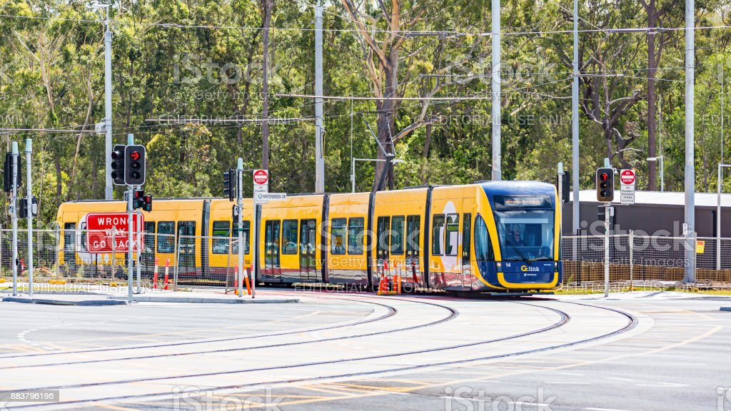 New G:link light rail vehicle turns at main road intersection stock photo