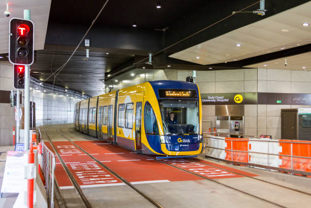 New G:link tram passing through Gold Coast University Hospital tunnel Southport, Australia – November 24, 2017: New G:link light rail vehicle #18 passing through Gold Coast University Hospital tunnel into station during testing and commissioning of GCLR Stage 2, a 7.3km line between Parkwood and Helensvale. electric train stock pictures, royalty-free photos & images