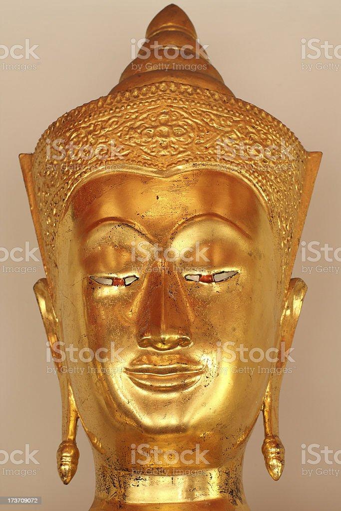 New golden Buddha face Close-up royalty-free stock photo