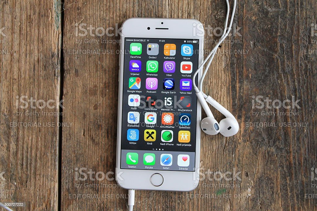 New Gray Iphone 6 On The Wooden Table Stock Photo - Download
