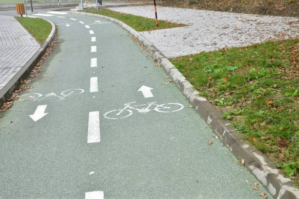 New green asphalt bike path in the city for active movement stock photo
