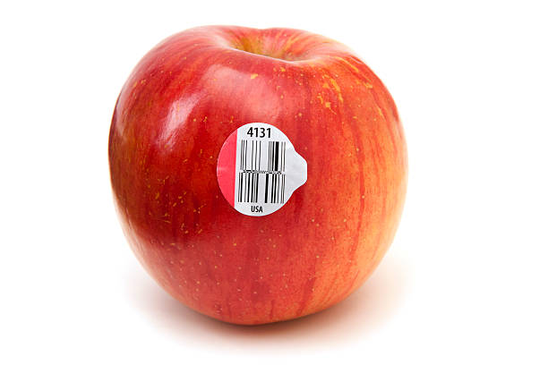 new gs1 databars (bar codes) on an apple - apple fruit stock photos and pictures