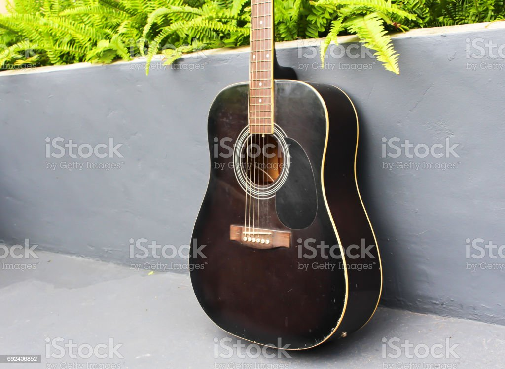 New guitar on the wall for play. stock photo