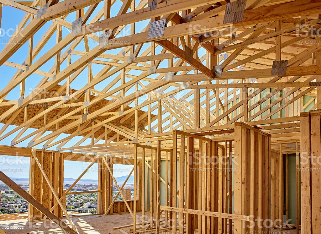 New hillside home wall framing and scissors roof truss details stock photo