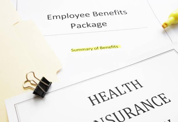 New hire Benefits documents stock photo