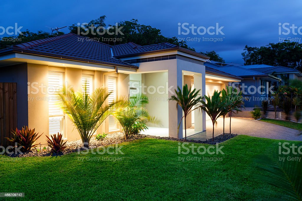 New home at dusk stock photo