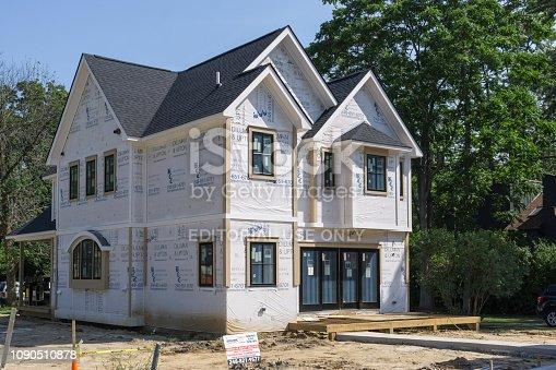 A construction site for a new single family home in Rochester, Michigan. A recent trend is to tear down older homes in smaller, but liveable communities, and replace them with large, modern homes.