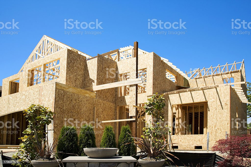 New Home Construction progress wood frame design landscaped sky stock photo