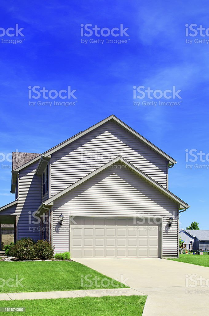 New home construction showing Vinyl Siding, Garage Door royalty-free stock photo
