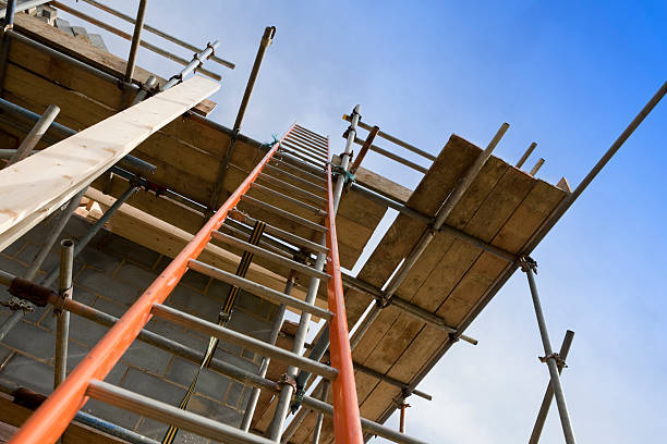 New Home Construction Site Scaffolding with Ladder Looking up to construction site scaffolding with tied in ladder. scaffolding stock pictures, royalty-free photos & images