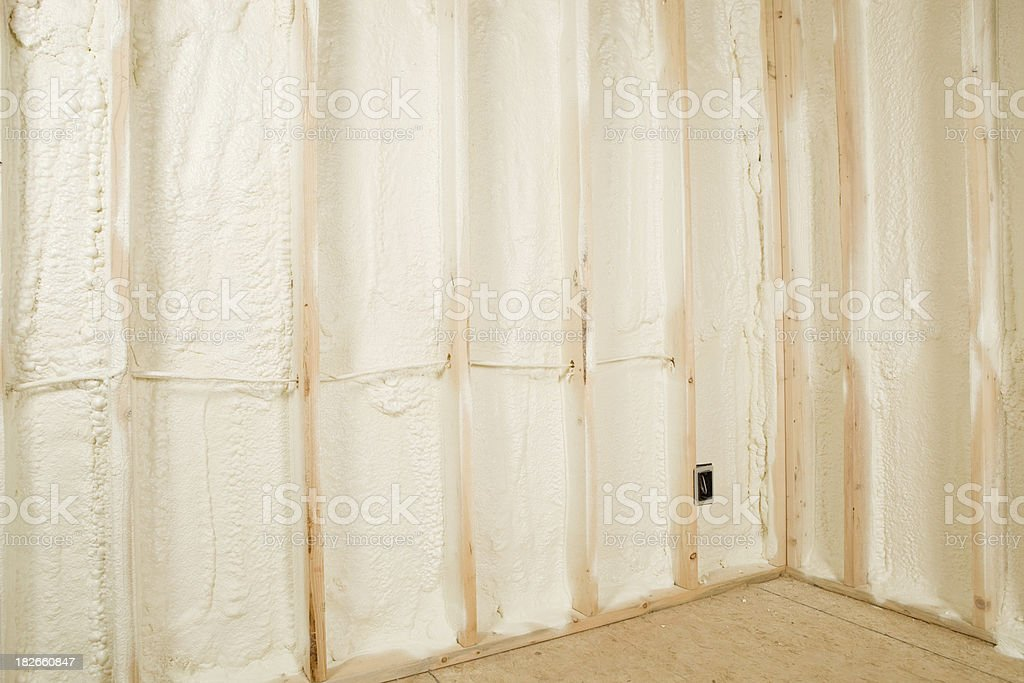 New Home Construction Walls Sprayed with Expandable Foam Insulation stock photo