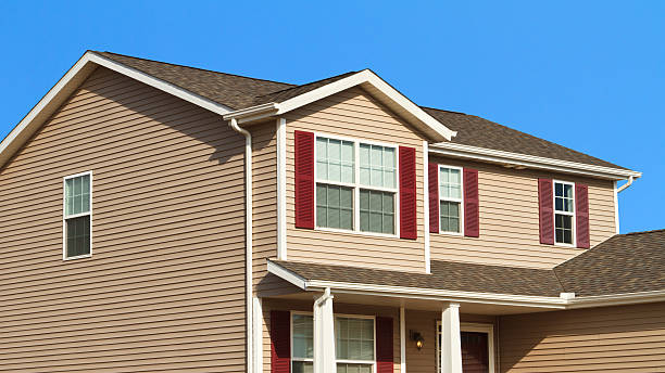 New home construction,showing siding,roof,and gutters stock photo