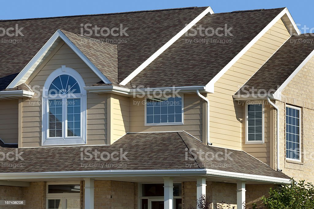 New Home Exterior; House With Architectural Asphalt Roof, Vinyl Siding stock photo
