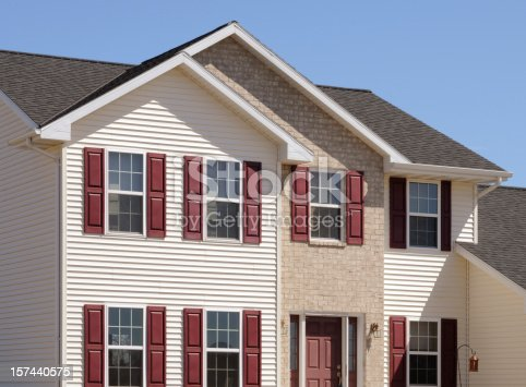 istock New Home With Brick and Vinyl Siding 157440575
