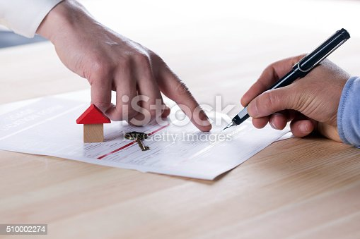 istock New homeowner signing contract of house sale or mortgage papers 510002274
