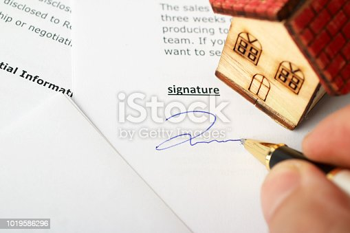 New homeowner signing contract of house sale