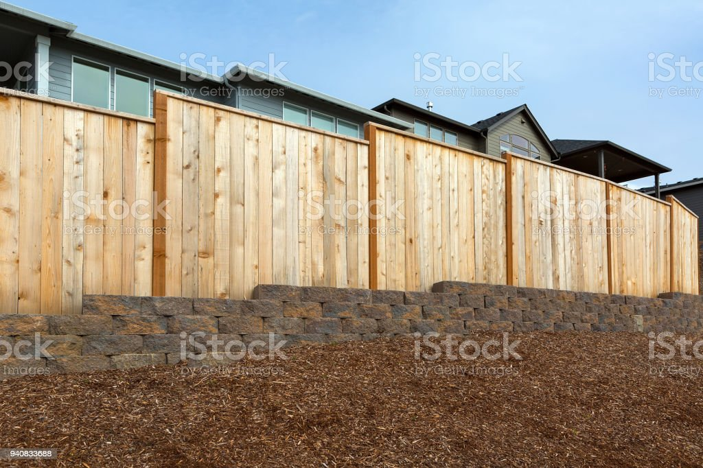 New homes backyard wood fence stone wall and landscaping garden...