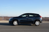 istock New Honda SUV HR-V model in motion with blue sky in background. 1134773523