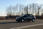 istock New Honda SUV HR-V model in motion with blue sky in background. 1134773546