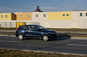 istock New Honda SUV HR-V model in motion with colourful houses in backround 1134773000