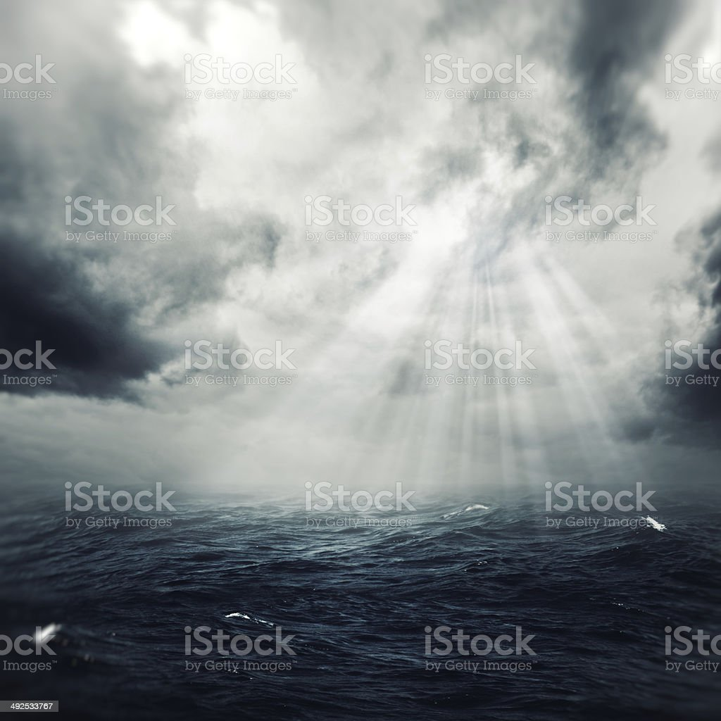 New hope in the stormy ocean, abstract environmental backgrounds stock photo
