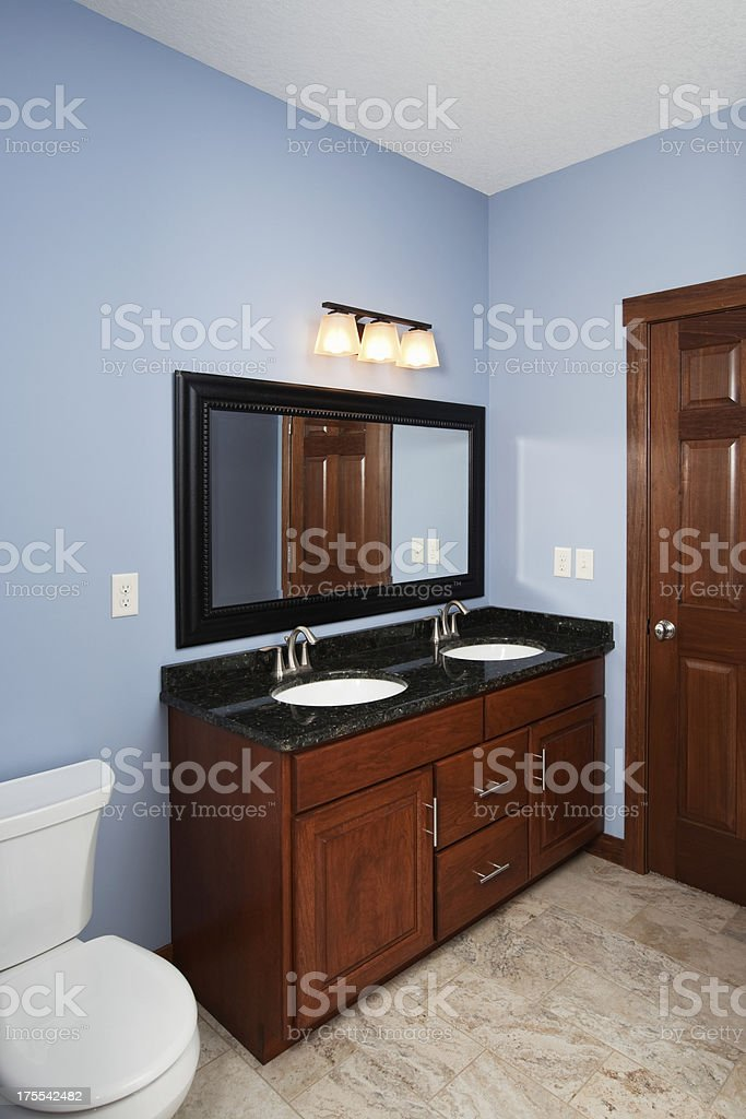 New House Bathroom with Double Vanity and Blue Walls stock photo