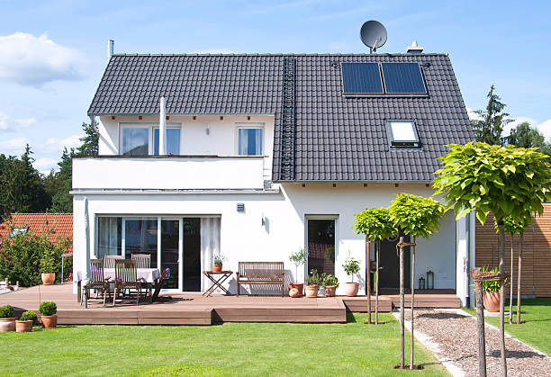 new house home view from garden with way - Einfamilienhaus new house built under construction with blue sky almost finished detached house stock pictures, royalty-free photos & images