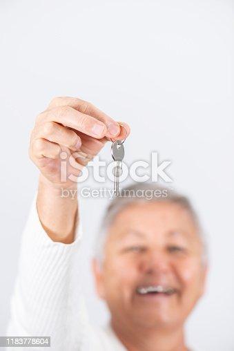 Senior woman holding the keys of their new house.