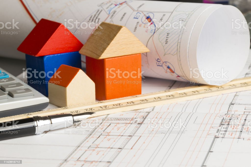 New house plan or project, with ruler, pen and miniature house from...