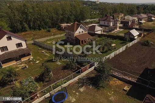 istock new house, the roof of which is made of metal. Cottage in the co 1190446698