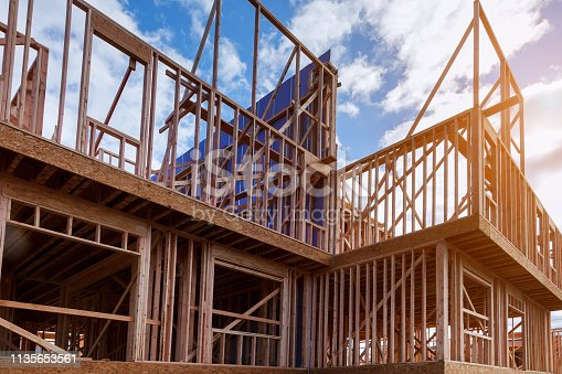 istock New house under construction framing against a blue sky 1135653561