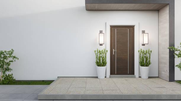 casa nova com porta de madeira e parede branca vazia. - fachada - fotografias e filmes do acervo