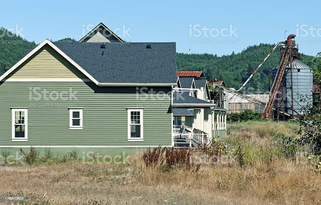 New houses and old lumber mill in Washington state royalty-free stock photo