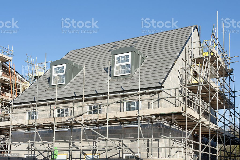 New houses under construction on a building site stock photo