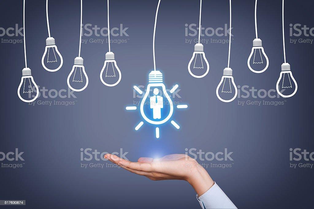 New Human Resource Idea Light Bulb on Human Hand stock photo
