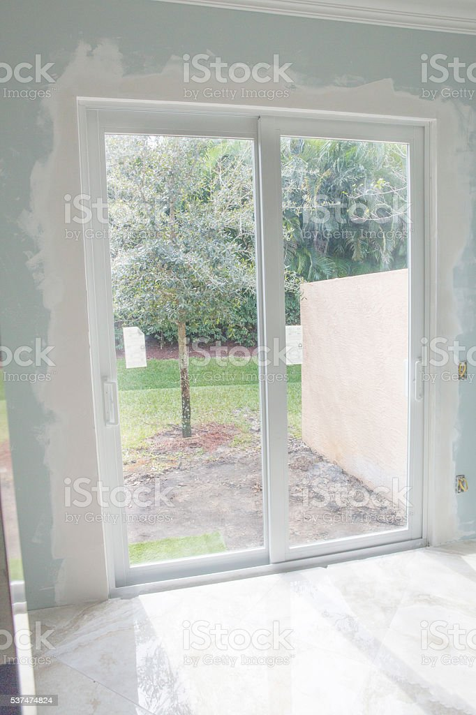 New Hurricane Proof Sliding Glass Doors Installed In Home Stock