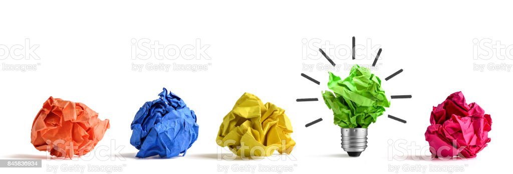 New idea concept. Colorful office paper balls and sketch of light bulb stock photo
