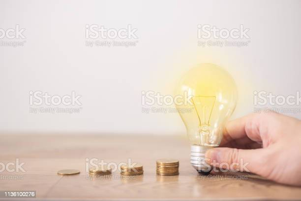 New idea concept with coins stack young women hand holding light bulb picture id1136100276?b=1&k=6&m=1136100276&s=612x612&h=0fteimrymgpe0u6deq4zo3gef6ug57zev6mk1zgm2we=