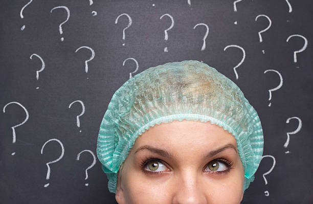 new ideas - question mark asking doctor nurse stock photos and pictures