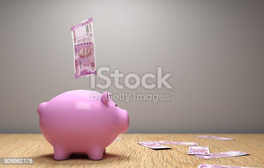 istock New Indian Currency with Piggy Bank 926962178