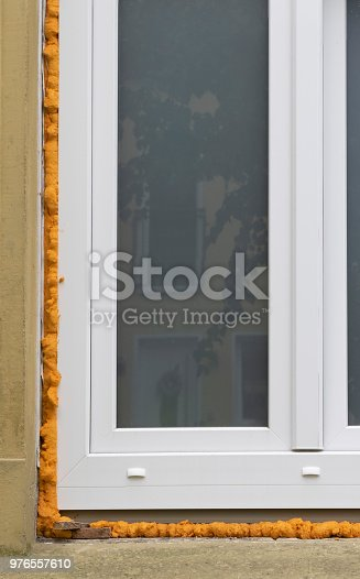 1070686034 istock photo New installed modern PVC windows with construction foam 976557610