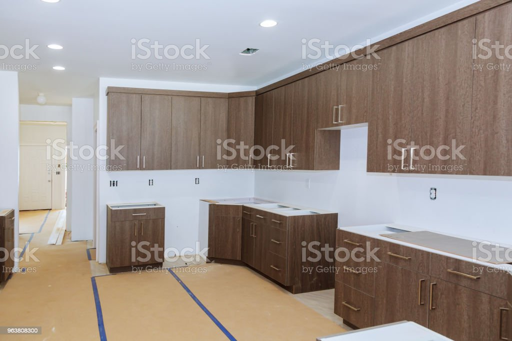 New Installed Wood Kitchen Cabinets With Modern Decorative Stainless Steel  Stock Photo - Download Image Now