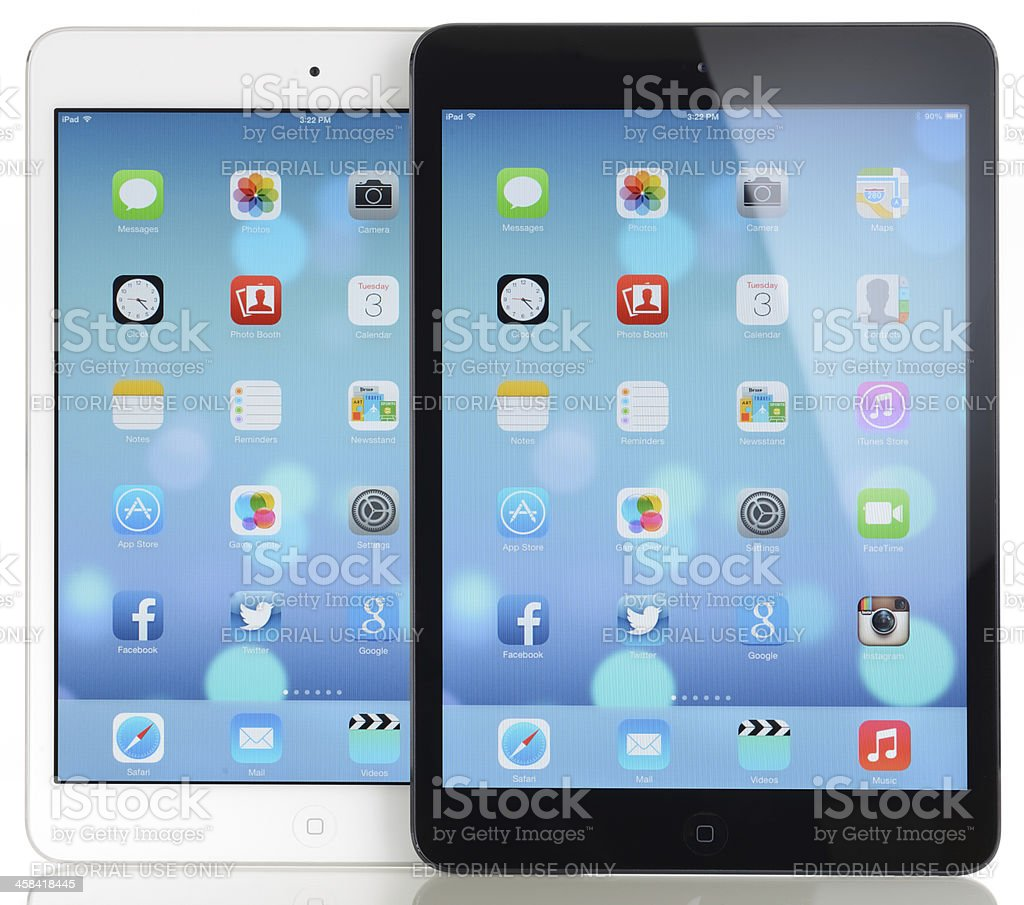 New iOS 7 operating system on two Apple iPad Mini royalty-free stock photo