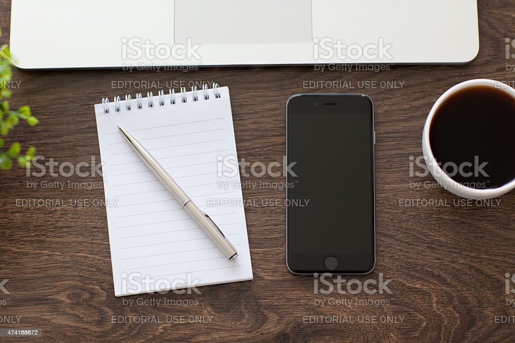 New iPhone 6 Space Gray and Macbook on the table stock photo